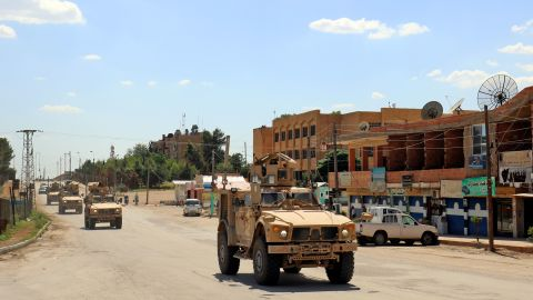 Vehicles of the US-led coalition battling the Islamic State group patrol the town of Rmelane in Syria's Hasakeh province on June 5, 2018. - The leading Syrian Kurdish militia said it would withdraw from Manbij, easing fears of a direct clash between NATO allies Washington and Ankara over the strategic northern town. Manbij is a Sunni Arab-majority town that lies just 30 kilometres (19 miles) south of the Turkish border, and where US and French troops belonging to the Western coalition against IS are stationed. (Photo by Delil souleiman / AFP)        (Photo credit should read DELIL SOULEIMAN/AFP/Getty Images)