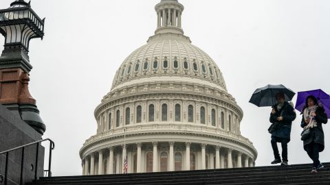 Tourists arrive to visit the U.S. Capitol on a rainy morning in Washington, Friday, Dec. 28, 2018, during a partial government shutdown.