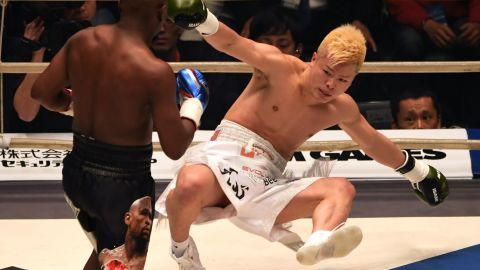 US boxing legend Floyd Mayweather Jr  knocks down Japanese opponent Tenshin Nasukawa in their exhibition bout in Saitama on New Year's Eve.