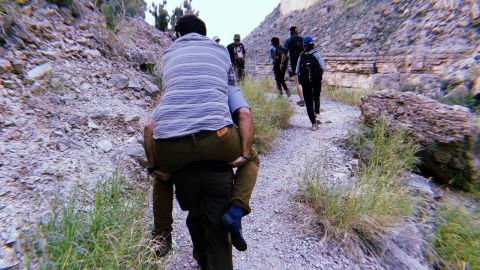 A park ranger helped carry Josh Snider out of a canyon.