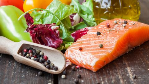 fresh salmon with vegetables on a wooden table; Shutterstock ID 324500189; Job: -