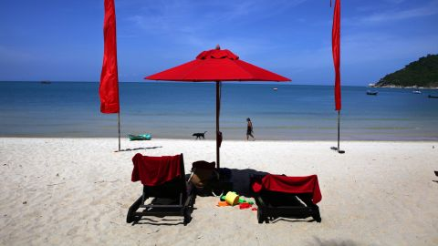 KOH PHANGAN THAILAND - JUNE 18:  A white sand beach decorated by red umbrellas at the Anantara Rasananda resort  June 18, 2012 on the island of Koh Phangan off the coast of Koh Samui . Thailand's official tourism body, the Tourism Authority of Thailand (TAT) has set itself the ambitious target of attracting more than 20 million tourists in 2012. According to TAT, In April, Thailand welcomed 1,659,021 international tourists which is a slight increase of 6.87% over the same in 2011.  (Photo by Paula Bronstein/Getty Images)