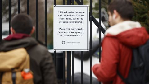 A closed sign is posted on the gate of Smithsonian's National Zoo on January 2.