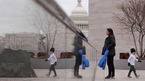 A woman and her child visit the tower deck at the National Gallery of Art in Washington on Wednesday, January 2. It was scheduled to close the next day because of the shutdown.