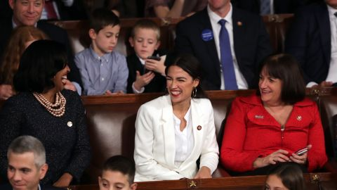 WASHINGTON, DC - JANUARY 3: Rep.-elect Alexandria Ocasio-Cortez (D-NY) along with other members of Congress during the first session of the 116th Congress at the U.S. Capitol January 03, 2019 in Washington, DC. Under the cloud of a partial federal government shutdown, Pelosi will reclaim her former title as Speaker of the House and her fellow Democrats will take control of the House of Representatives for the second time in eight years. (Photo by Chip Somodevilla/Getty Images)
