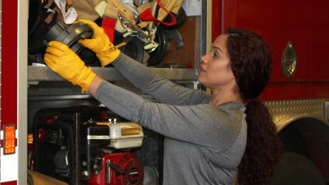 Vivi Rodriguez, a firefighter/paramedic with a large city fire department, wears SeeHerWork gloves on the job.