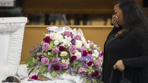 A mourner approaches Jazmine's casket during a viewing Tuesday.