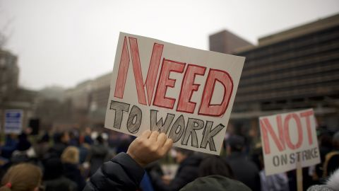 """Fred Jennings, 67, holds a placard stating """"NEED TO WORK"""" while gathering with area elected officials and furloughed federal workers at a rally in front of Independence Hall on January 8, 2019 in Philadelphia, Pennsylvania.  The government shutdown, now lasting 18 days, marks the second longest United States in history, affecting about 800,000 federal employees.  (Photo by Mark Makela/Getty Images)"""