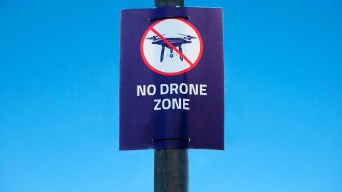 """A """"no drone zone"""" poster is seen at Gatwick Airport, which was brought to a halt for 36 hours in December following drone sightings."""