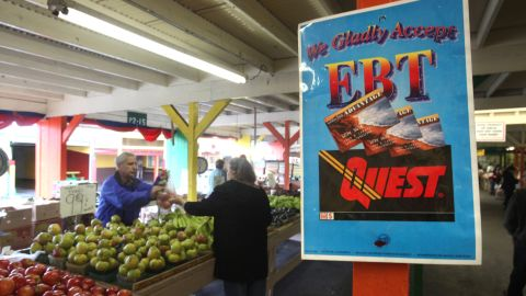 In this photo taken Saturday, Feb. 6, 2010, a sign announcing the acceptance of electronic Benefit Transfer cards is seen at a farmers market in Roseville, Calif.   Currently food stamp recipients have had problems purchasing food at farmer's markets  because many of them do not accept the EBT cards that food stamp recipients use to buy groceries.(AP Photo/Rich Pedroncelli)