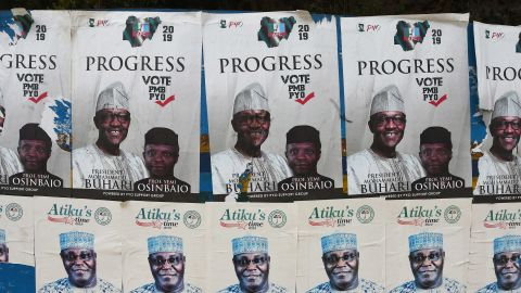 A picture shows campaign posters for Nigeria's incumbent president and candidate to his re-election for the ruling All Progressives Congress (APC) President Muhammadu Buhari, and Vice-President Yemi Osinbajo, placarded beside campaign posters for the presidential candidate of the opposition People's Democratic Party (PDP) Atiku Abubakar at a bus station in Lagos, on January 4, 2019, ahead of Nigeria's general elections of Ferbuary 16, 2019. (Photo by PIUS UTOMI EKPEI / AFP)        (Photo credit should read PIUS UTOMI EKPEI/AFP/Getty Images)