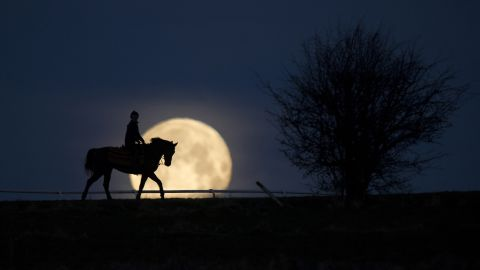 """Multi award-winning snapper Edward Whitaker earned horse racing's photograph of the year award with this stunning image of a rare blue supermoon in Lambourn, Berkshire in January 2018. """"I knew a spot where the angle was just right,"""" he says. Here he talks CNN Sport through seven of his favorite images."""