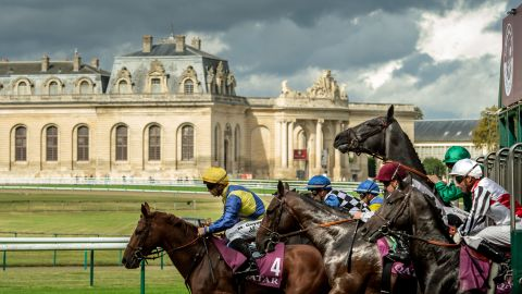 """Horses break from the stalls in front of the Great Stables at Chantilly, France in 2016. """"I love this shot because of the light and the horse rearing  at the start. It's just a dramatic picture. That one horse going up gives it great strength."""""""