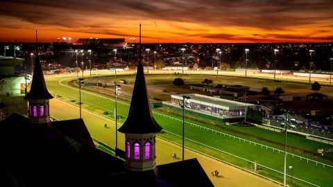 """This color-filled image of Churchill Downs is another Whitaker favorite. """"I knew there was this fire exit up to a door that opened onto the roof so I went up there and caught this great dawn. There was a cold front coming in, so I knew there would be some very dramatic reds and yellows in the sky. And now they light up the iconic spires with purple light, so the colors are unbelievable. It's so American and over the top."""""""