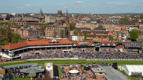 """Whitaker conquered his fears and rode up in the TV crane to capture this image of the city of Chester and the racecourse. """"This is the scariest picture I've ever taken.  You go up on this wobbly plank with a safety harness clipped to a metal frame. I was absolutely terrified but the view was amazing, the light was just right and I got this great scene of Chester with the action on the racecourse."""""""