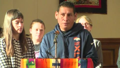 Miguel Ramirez Valiente speaks to reporters from the pulpit at All Souls Unitarian Universalist Church in Colorado Springs, Colorado, where he says he's taken sanctuary because he can't fight his case in court.