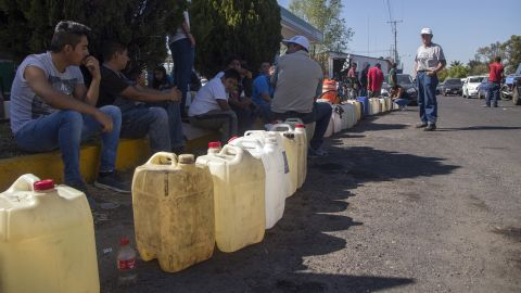 People buy gasoline at a gas station in Mexico's Michoacan state, one of several Mexican states where shortages have been reported, on January 8, 2019.
