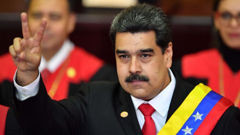 Venezuela's President Nicolas Maduro flashes the victory sign after being sworn-in for his second mandate, at the Supreme Court of Justice (TSJ) in Caracas on January 10, 2019. - Maduro begins a new term that critics dismiss as illegitimate, with the economy in free fall and the country more isolated than ever. (Photo by Yuri CORTEZ / AFP)        (Photo credit should read YURI CORTEZ/AFP/Getty Images)