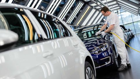 An employee polishes an e-Golf electric inside the Volkswagen factory in Dresden, Germany.