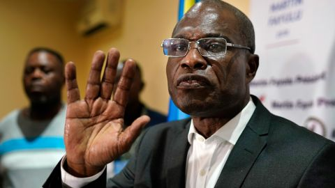 Opposition candidate Martin Fayulu speaks to the press at his headquarters in Kinshasa, Congo, Thursday Jan. 10, 2019. Fayulu, who came second in the presidential poll behind Felix Tshisekedi, called the results fraudulent. (AP Photo/Jerome Delay)