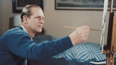 """Prince Philip paints during the filming of the documentary """"Royal Family"""" in 1969."""