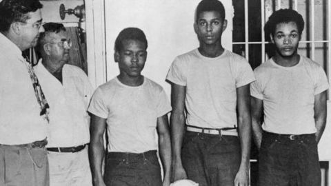 In this undated image released by the State Library and Archives of Florida, Lake County Sheriff Willis McCall, far left, and an unidentified man stand next to Walter Irvin, Samuel Shepherd and Charles Greenlee, from left, in Florida. The three men along with a fourth were charged with rape in 1949.