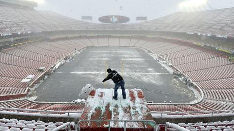 Kyle Haraugh of NFL Films clears snow from a camera location at Arrowhead Stadium on Sunday, January 13, 2019, in Kansas City, Missouri.