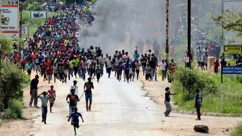 Protestors gather on the streets during demonstrations over fuel prices in Harare, Zimbabwe, on Monday.