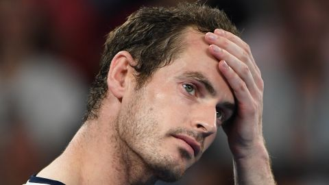 TOPSHOT - Britain's Andy Murray reacts during an interview after his defeat against Spain's Roberto Bautista Agut during their men's singles match on day one of the Australian Open tennis tournament in Melbourne on January 14, 2019. (Photo by SAEED KHAN / AFP) / -- IMAGE RESTRICTED TO EDITORIAL USE - STRICTLY NO COMMERCIAL USE --        (Photo credit should read SAEED KHAN/AFP/Getty Images)