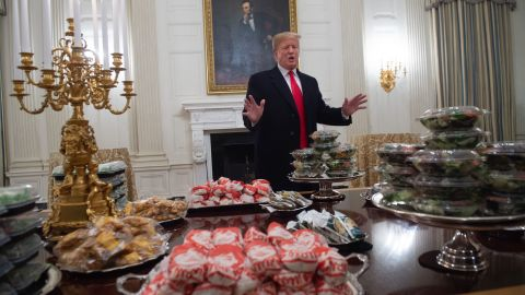 US President Donald Trump speaks alongside fast food he purchased for a ceremony honoring the 2018 College Football Playoff National Champion Clemson Tigers.