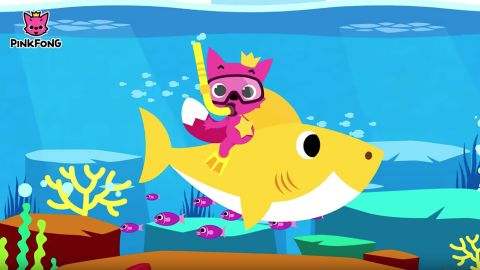 """Baby Shark with Pinkfong's mascot. The Pink Fox, also named """"Pinkfong,"""" frequently appears in their videos."""