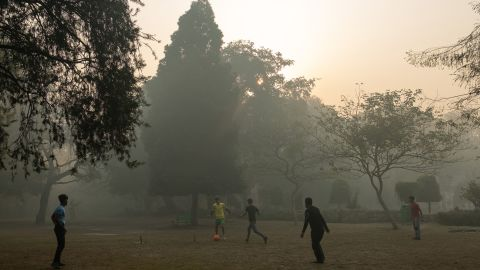 Indian youths play football amid air pollution smog at Lodhi Gardens in New Delhi on January 12, 2019. - Smog levels spike during winter in northern India, when air quality often eclipses the World Health Organization's safe levels. (Photo by Laurène Becquart / AFP)        (Photo credit should read LAURENE BECQUART/AFP/Getty Images)