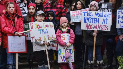 Elementary school students supported the teachers' strike outside Hamilton High School.