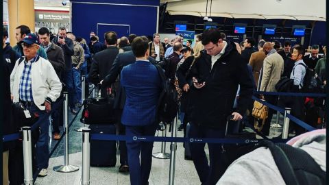 Some travelers waited in security lines for more than two hours at Atlanta's Hartsfield-Jackson International Airport on Monday. The government shutdown has led to increased absences among TSA workers nationwide, putting a strain on airport checkpoints.