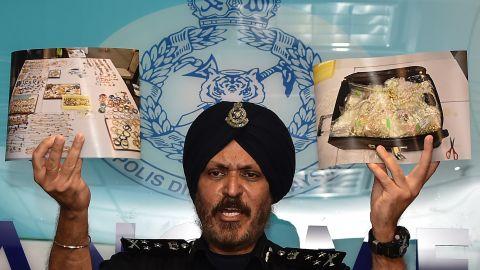 Malaysian police display photos of luxury goods seized from Najib's home in Kuala Lumpur.