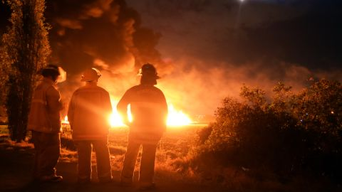 Firefighters stand at the scene of the explosion January 18 in Tlahuelilpan.