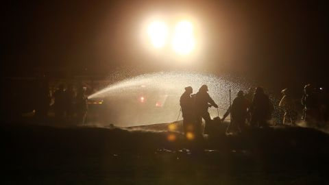 Firefighters work to control the fire January 19. State oil company Pemex initially blamed illegal taps in the pipeline for the explosion. It later said it was launching an investigation into the cause of the blast.