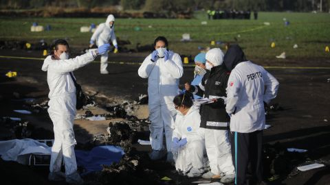 Forensic doctors work at the scene of the pipeline explosion January 19.