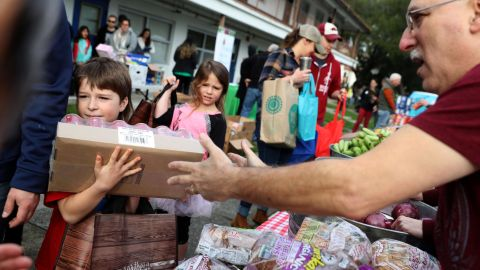 US Coast Guard families receive free groceries during a food giveaway in Novato, California, on Saturday, January 19. Thousands of active-duty Coast Guard members weren't getting paid during the shutdown. The Coast Guard is the only military branch under the Department of Homeland Security.