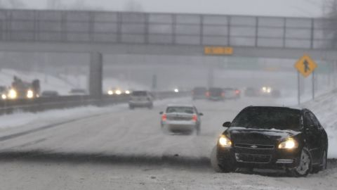 A vehicle spins out on Interstate 94 in Detroit, Saturday, Jan. 19, 2019. The massive storm dumped 10 inches of snow on some areas of the Midwest. Following the storm system, some areas were expecting high winds and bitter cold, and in Iowa, temperatures in the teens Saturday were expected to drop below zero overnight, producing wind chills as low as 20-below by Sunday morning. (AP Photo/Paul Sancya)