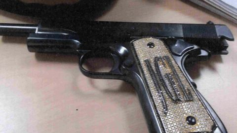A photo of a diamond-encrusted pistol was among the evidence presented in the case.