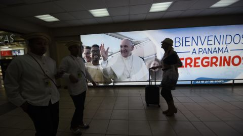 """A sign with a photo of Pope Francis, reading """"Welcome to Panama, Pilgrims,"""" at the Tocumen airport ahead of World Youth Day."""