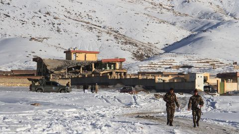 Afghan security forces walks near a site after a car bomb attack on a military base in the central province of Maidan Wardak on January 21, 2019.