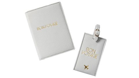 """<strong>This classic passport holder and luggage tag duo for all your jet-setting needs ($40; </strong><a href=""""https://www.anthropologie.com/shop/bon-voyage-travel-set"""" target=""""_blank"""" target=""""_blank""""><strong>anthropologie.com</strong></a><strong>)</strong>"""