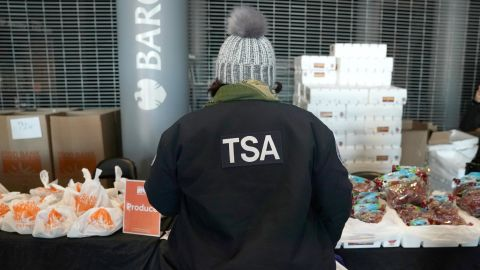 A furloughed Transportation Security Administration (TSA) employee looks at food at the Barclays Center as the Food Bank For NYC holds food distribution for federal workers impacted by the government shutdown in Brooklyn, New York January 22, 2019. (Photo by TIMOTHY A. CLARY / AFP)        (Photo credit should read TIMOTHY A. CLARY/AFP/Getty Images)