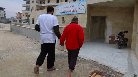 An unnamed patient enters rebel-held Idlib's only rehabilitation center for drug addicts.