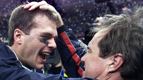 New England Patriots quarterback Tom Brady celebrates with head coach Bill Belichick after their win over the St. Louis Rams in Super Bowl XXXVI in New Orleans on February 3, 2002.