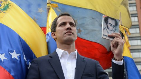 """Venezuela's National Assembly head Juan Guaido declares himself the country's """"acting president"""" during a mass opposition rally against leader Nicolas Maduro, on the anniversary of a 1958 uprising that overthrew military dictatorship in Caracas on January 23, 2019. - Moments earlier, the loyalist-dominated Supreme Court ordered a criminal investigation of the opposition-controlled legislature. """"I swear to formally assume the national executive powers as acting president of Venezuela to end the usurpation, (install) a transitional government and hold free elections,"""" said Guaido as thousands of supporters cheered. (Photo by Federico PARRA / AFP)        (Photo credit should read FEDERICO PARRA/AFP/Getty Images)"""