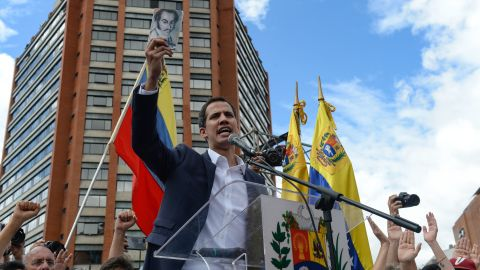"""Venezuela's National Assembly head Juan Guaido speaks to the crowd during a mass opposition rally against leader Nicolas Maduro in which he declared himself the country's """"acting president"""", on the anniversary of a 1958 uprising that overthrew military dictatorship, in Caracas on January 23, 2019. - """"I swear to formally assume the national executive powers as acting president of Venezuela to end the usurpation, (install) a transitional government and hold free elections,"""" said Guaido as thousands of supporters cheered. Moments earlier, the loyalist-dominated Supreme Court ordered a criminal investigation of the opposition-controlled legislature. (Photo by Federico PARRA / AFP)        (Photo credit should read FEDERICO PARRA/AFP/Getty Images)"""