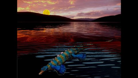 This artist's illustration shows a marine reptile similar to a platypus hunting at dusk. This duckbilled animal was the first reptile to have unusually small eyes that most likely required it to use other senses, such as the tactile sense of its duckbill, to hunt for prey.